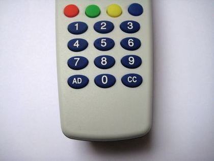 Figure 10. Remote control with 'AD' and 'CC' buttons for activating and deactivating audio description and closed captions (subtitles for people who are deaf or hard of hearing).